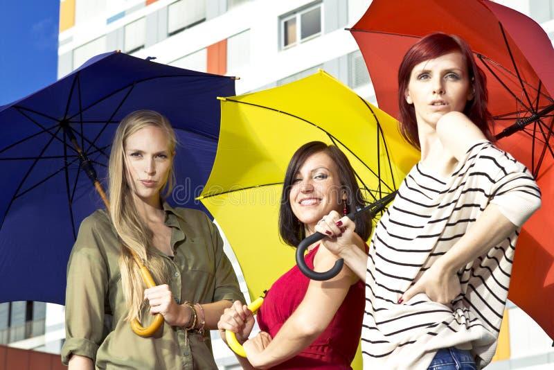 Girls with umbrellas stock image