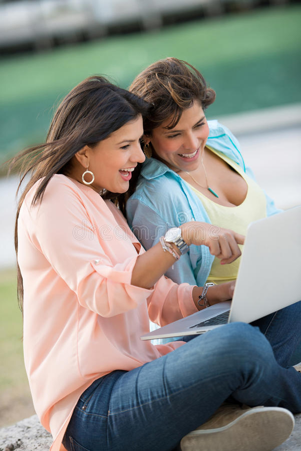 Download Girls using a laptop stock photo. Image of online, smile - 30763694