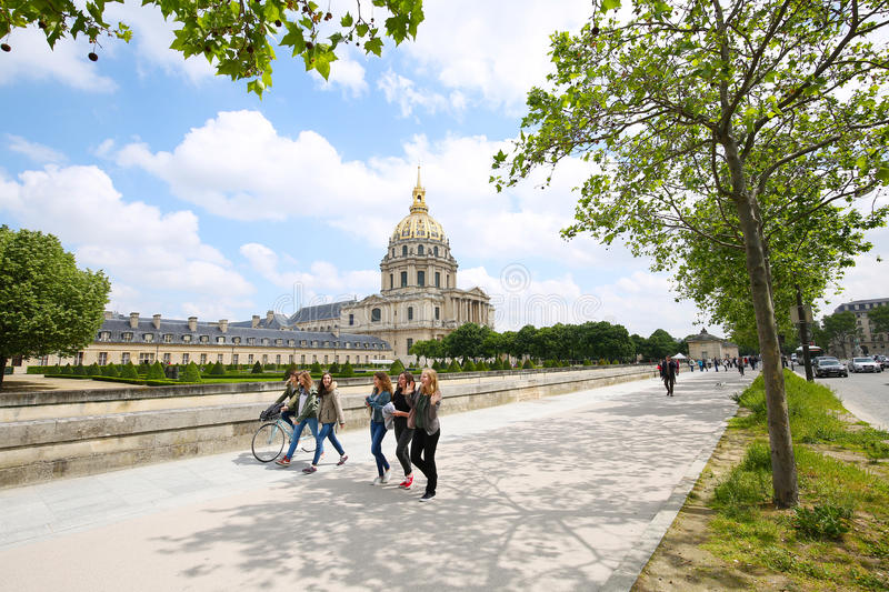 Girls walking in front of the Dome des Invalides. PARIS, FRANCE, MAY 25, 2016: Young girls walking in front of The Dome des Invalides, home of Napoleon's tomb royalty free stock image
