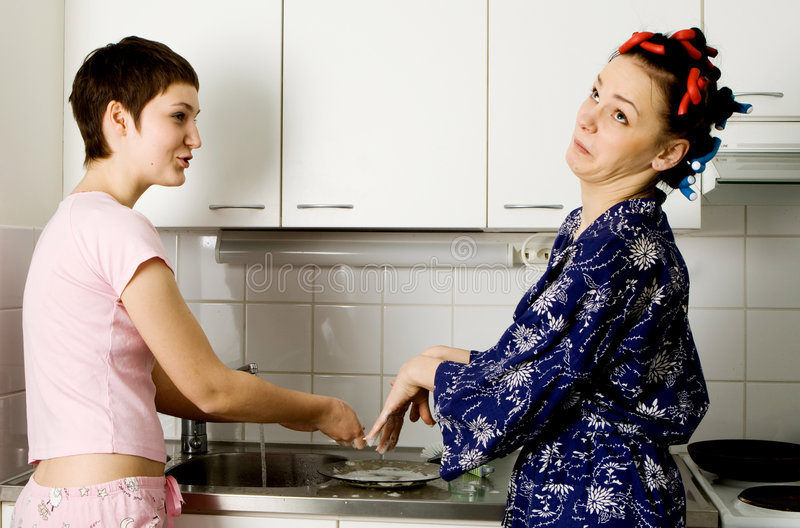 Girls Washing The Plate stock image