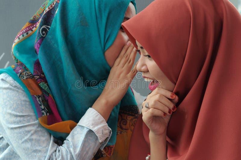 Girls whispering stock photos