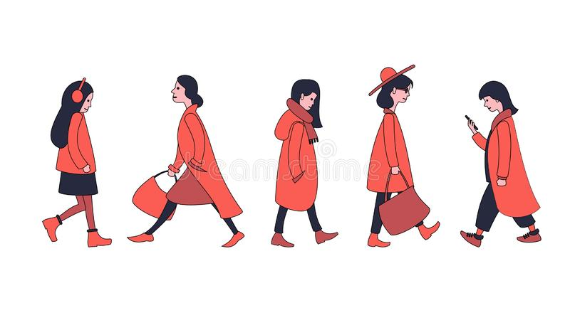 A set of walking people in outerwear. stock illustration