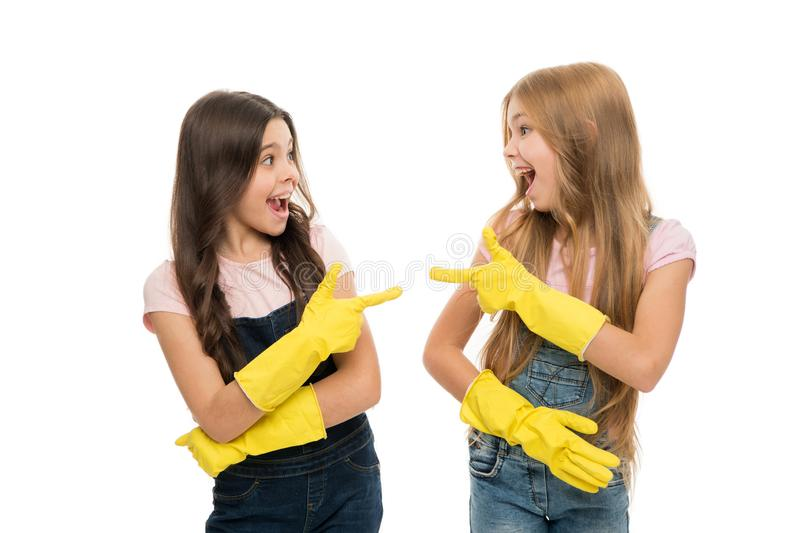Girls with yellow rubber protective gloves ready for cleaning. Household duties. Little helper. Girls cute kids love. Cleaning around. Keep it clean. Protect royalty free stock images