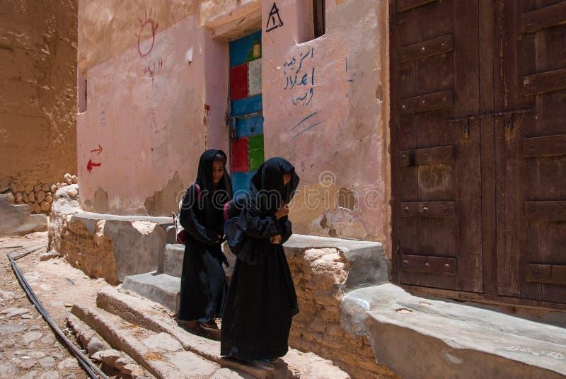 Girls in Yemen. Two girls return from school on May 4, 2007 in Al Hajarayn, Yemen. Although infant mortality is high, children in Yemen are culturally, socially stock image