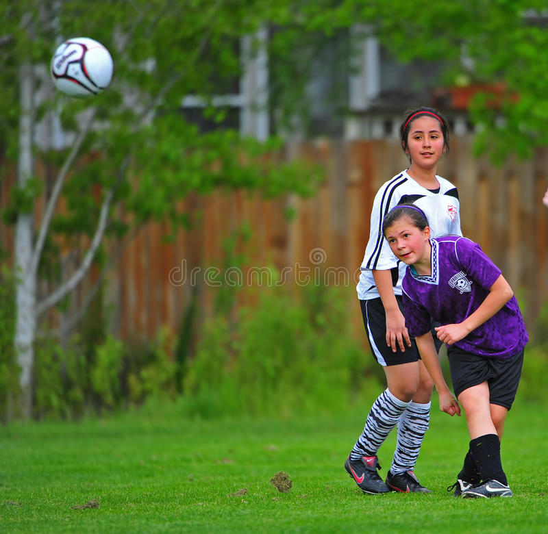 Girls Youth soccer kick stock photos