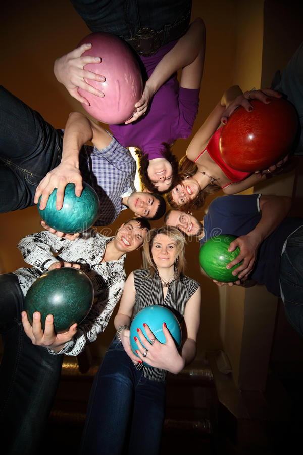 Girls and youths stand in close circle with balls stock photo