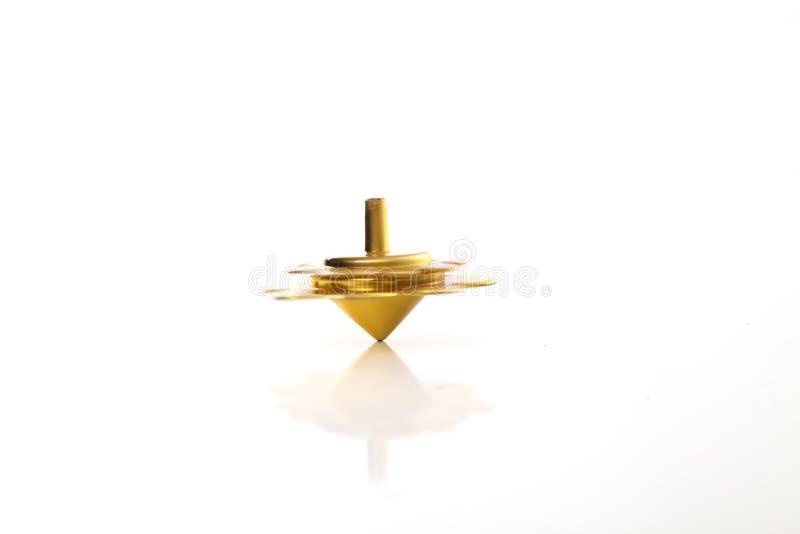 Giro dourado do dreidel do Hanukkah imagens de stock