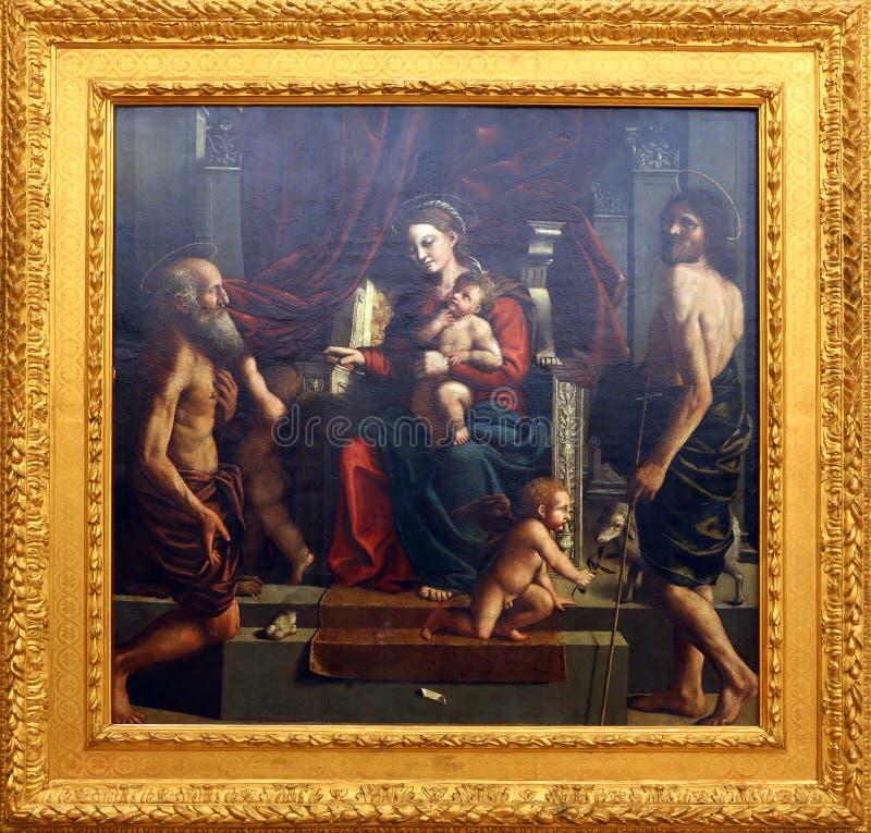 Girolamo da Carpi: Madonna e criança com St Jerome e John The Baptist fotos de stock royalty free