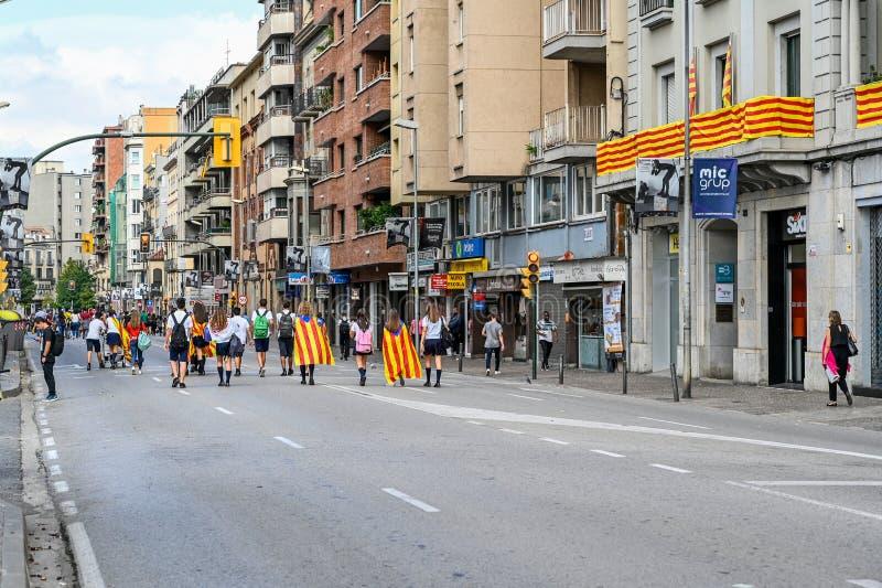 Girona Catalonia Spain demonstrants walking through the city royalty free stock photo