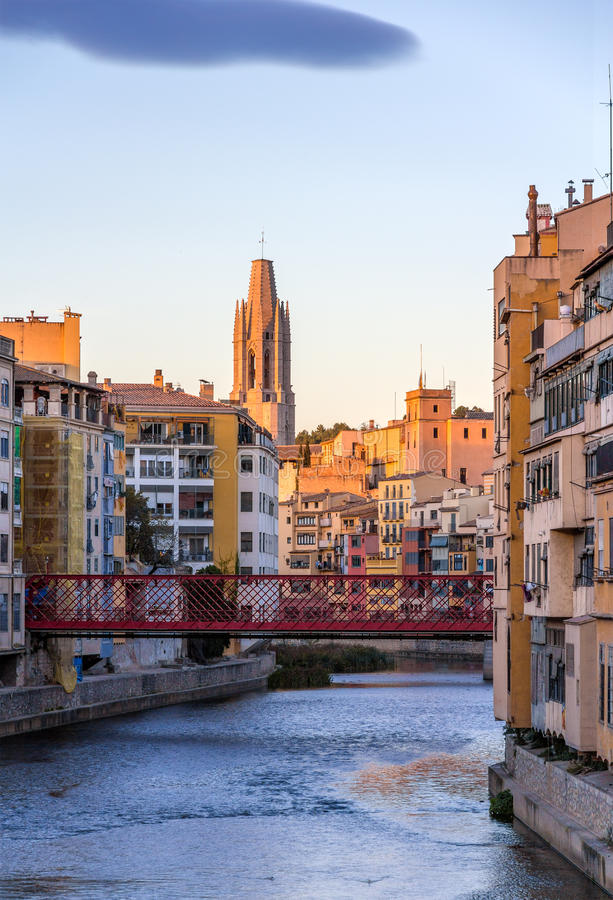 Girona Cathedral with Eiffel bridge over Onyar River royalty free stock images