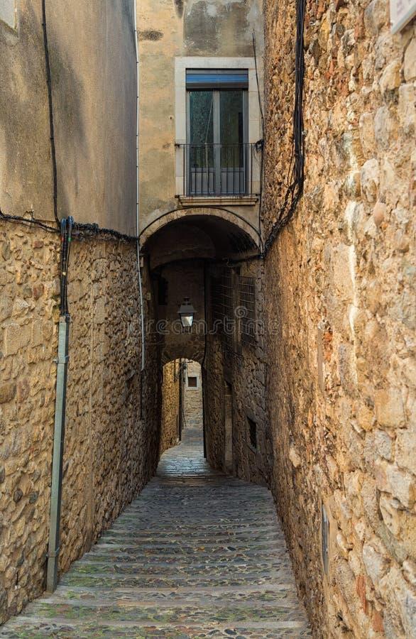 Girona, narrow medieval street, old Jewish Quarter stock photo