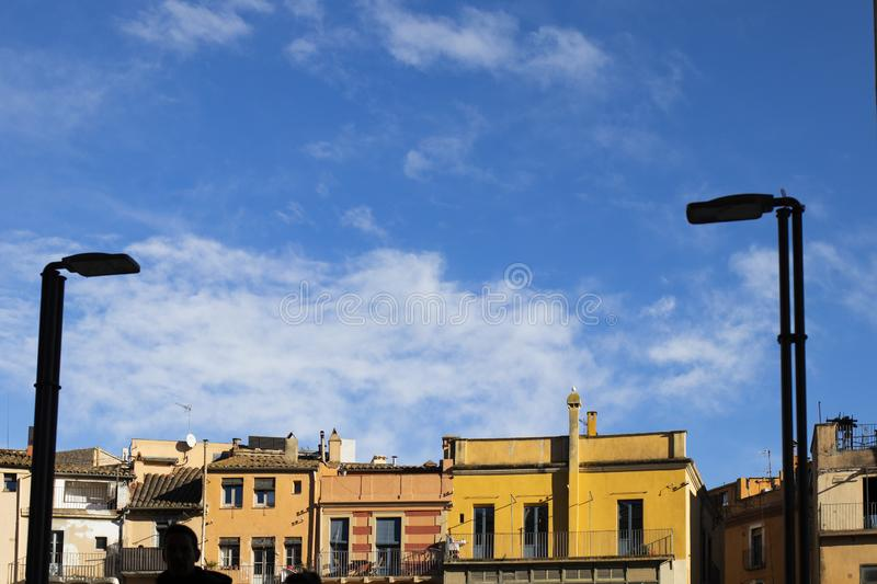 Girona roof cityscape with old building facade on a blue sky. In a landmark travel destination stock photo