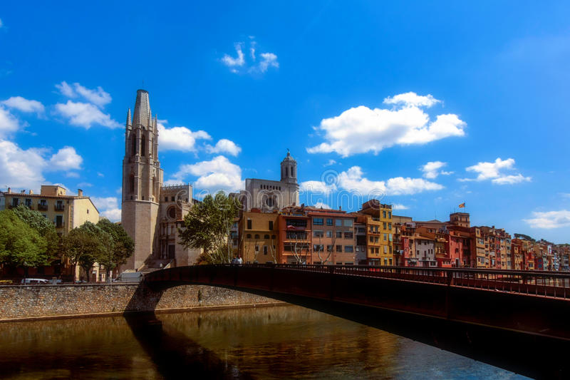 Girona, Spain, may 2016: Collegiate Church of Sant Feliu (Felix) beyond Sant Feliu Bridge across Onyar River in Girona, Catalonia stock images