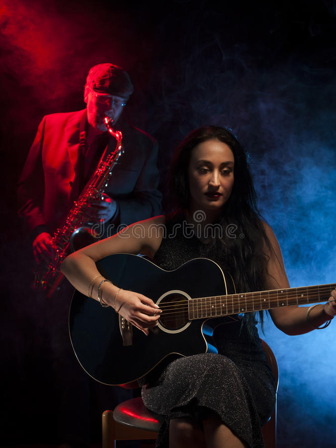 Gitaar en Saxofoon royalty-vrije stock afbeeldingen