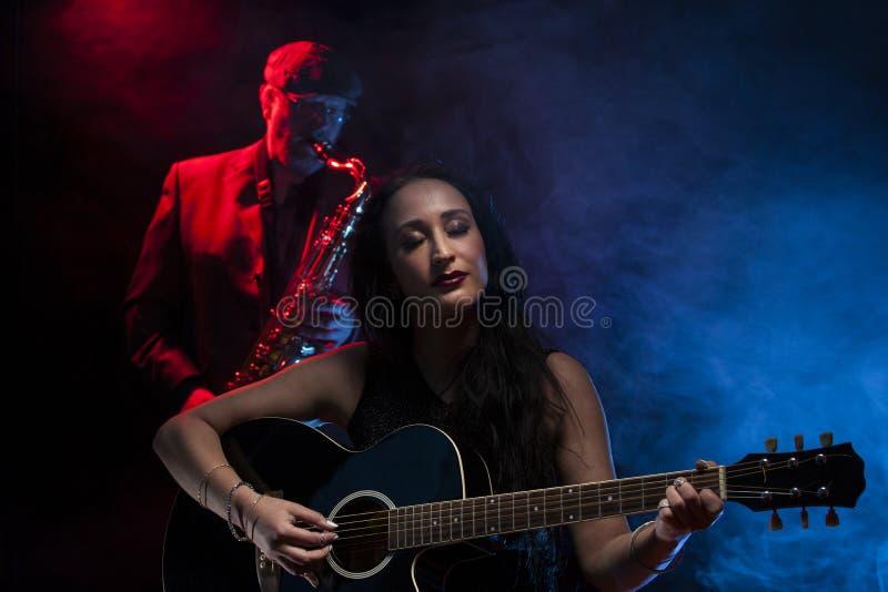 Gitaar en Saxofoon stock afbeelding