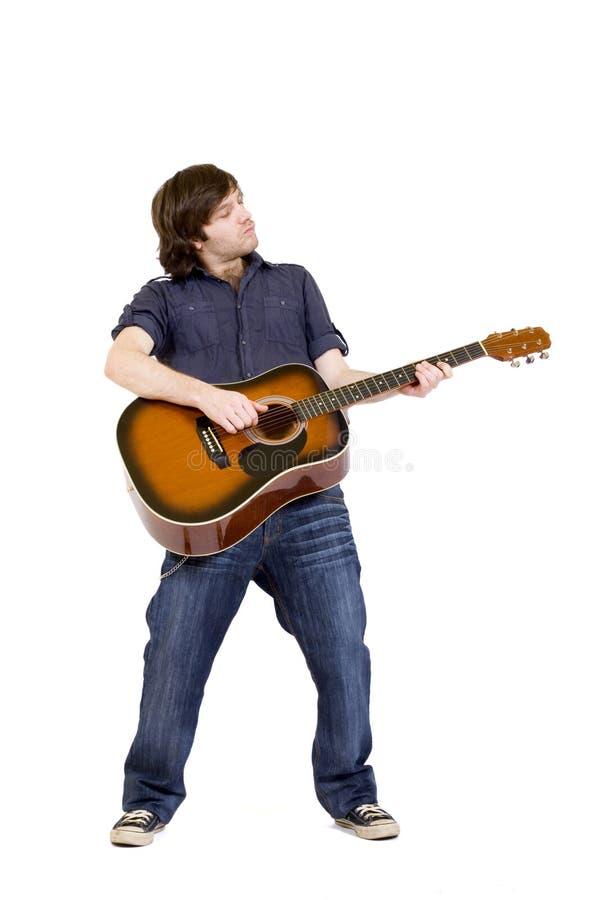 gitarr hans leka för man royaltyfria bilder