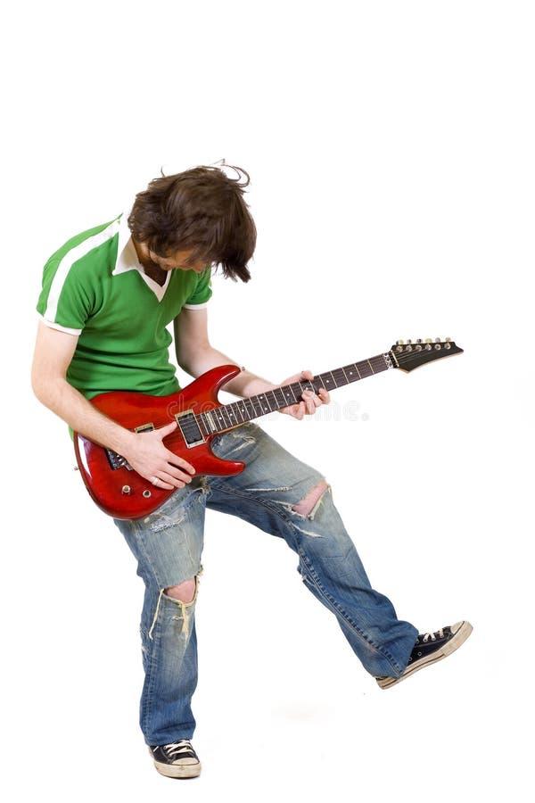 gitarr hans passionerade leka för spelare royaltyfria bilder