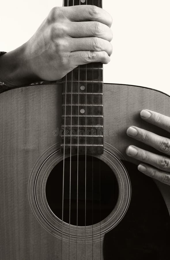 Gitarre und Hand stockbild