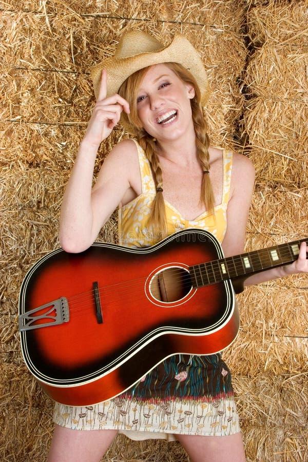 Gitarren-Frau lizenzfreie stockfotografie