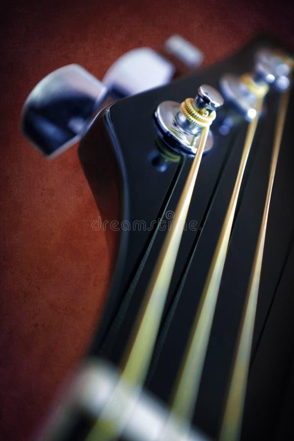 Gitarrhuvudmateriel arkivfoto