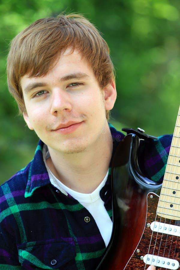 Download Gitarrist fotografering för bildbyråer. Bild av spänning - 19783827