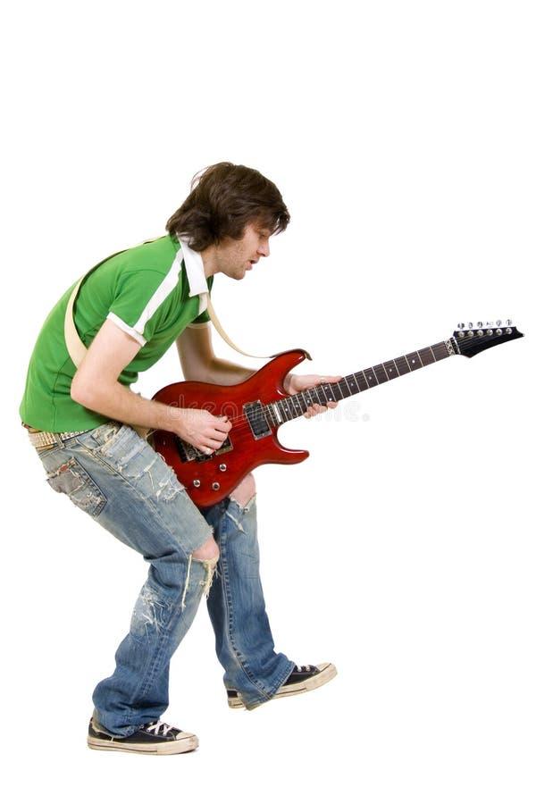 Gitarrist, der über Weiß spielt stockbild