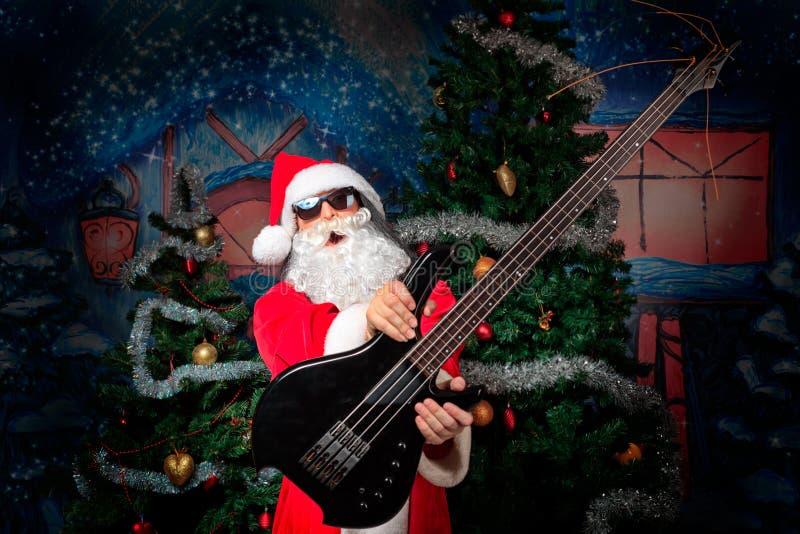gitarrist santa royaltyfri foto