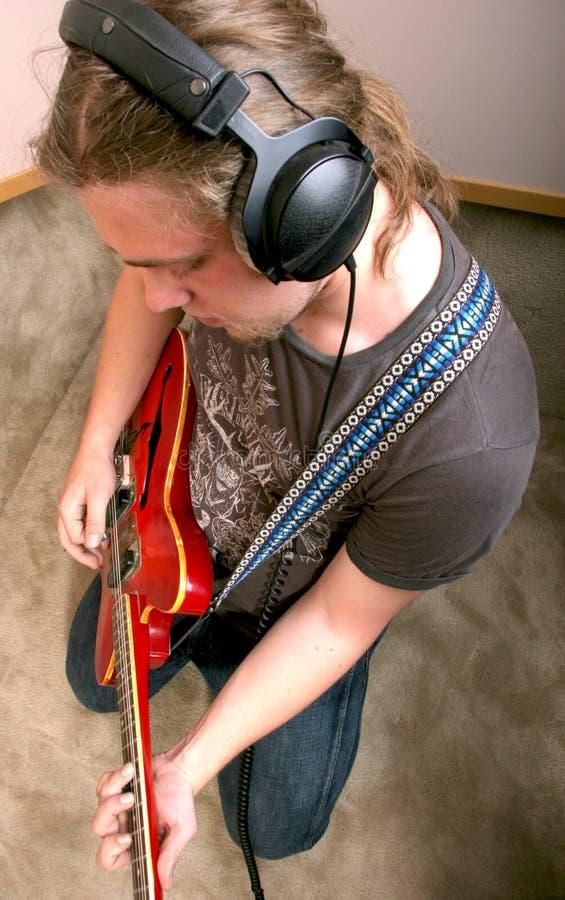 gitarriststudio arkivfoton