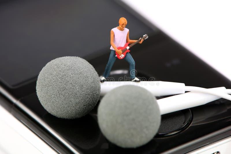 gitarrminiatyrspelare mp3 fotografering för bildbyråer