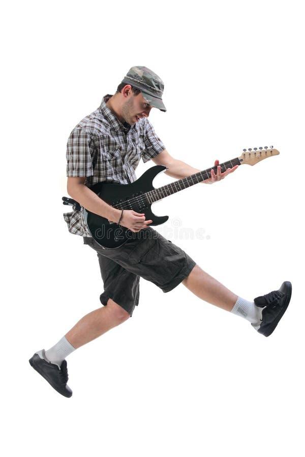 gitary w powietrzu skokowy gracz zdjęcie stock