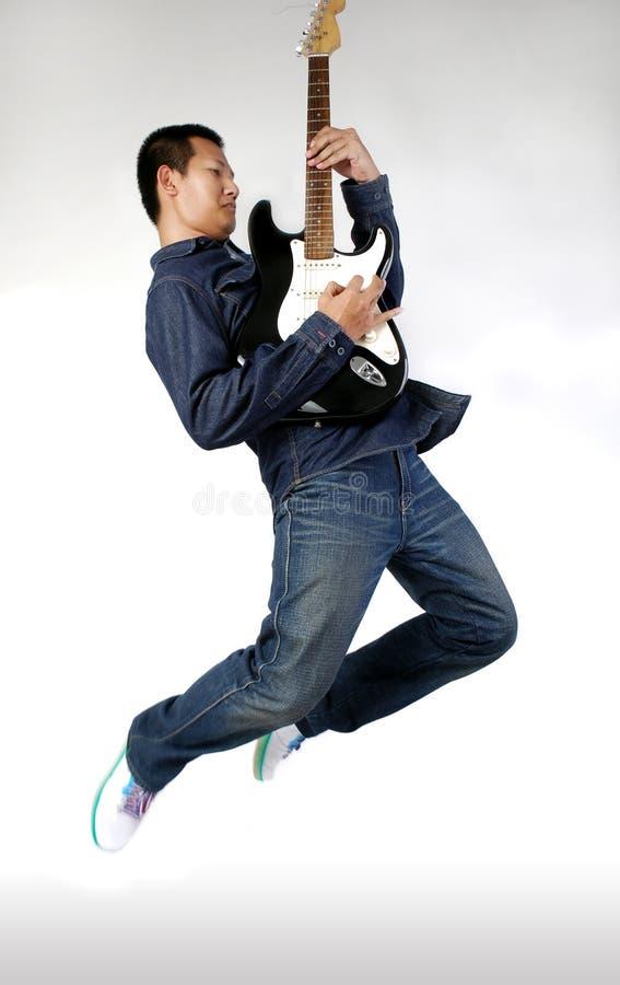 gitarzysta airborn zdjęcie stock