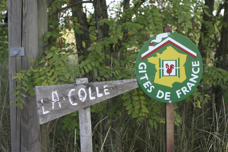 Gites de France sign in foliage with a house name sign. royalty free stock images