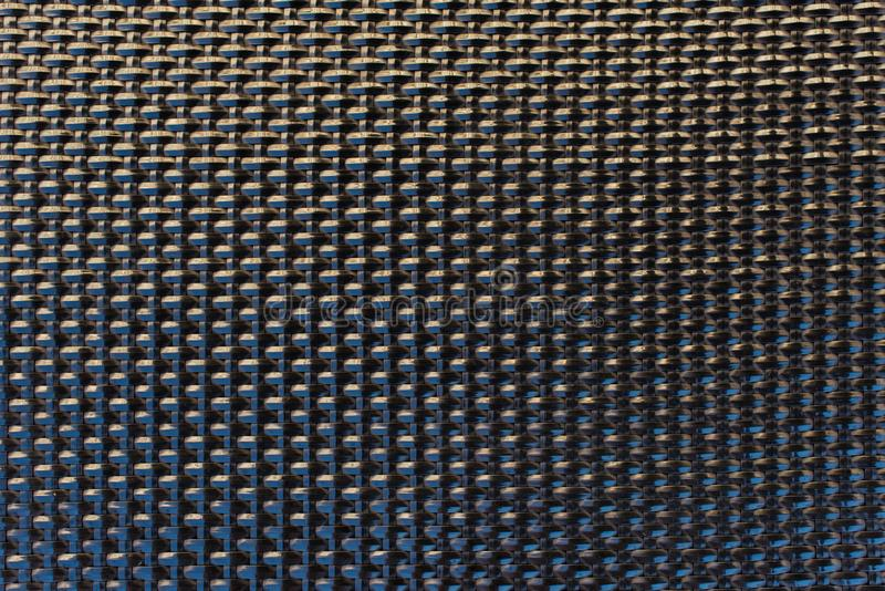 Gitter-Beschaffenheitsplastikmuster des Nahaufnahmeschwarzen geflochtes lizenzfreie stockfotografie