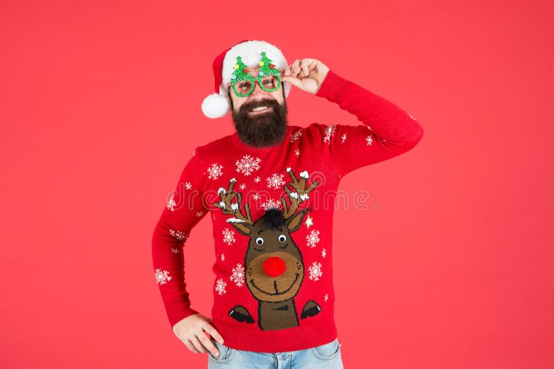Give a big chee. funny hipster knitted sweater. knitwear fashion. winter holiday celebration. bearded man santa hat red royalty free stock photos