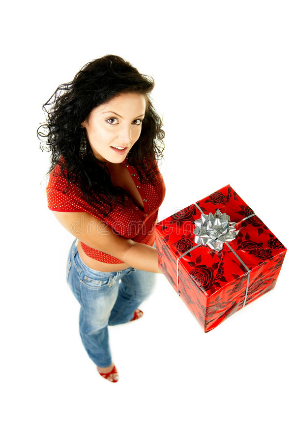 Give a gift. Beautiful woman with boxed gift in her hands royalty free stock photos
