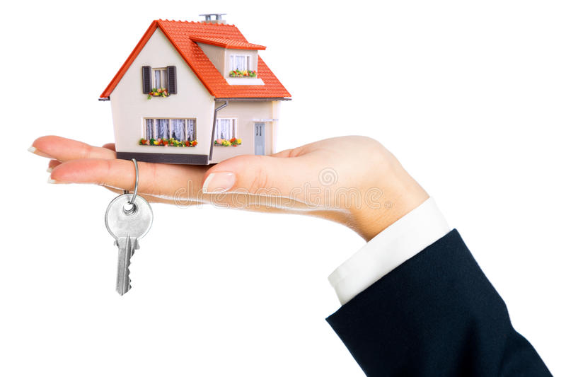 Give house and key. Concept of real estate purchase stock image