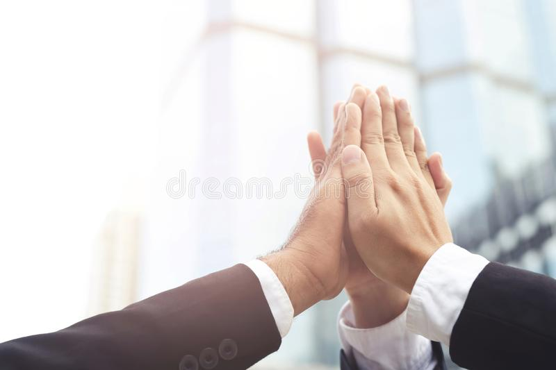 Give me five your clap hands articulate group businessman for good business team. concept Success and encouragement to overcome royalty free stock image
