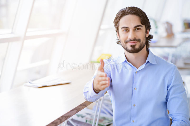 Give me young friendly handshake stock photos