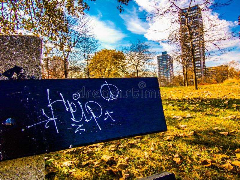 Give peace a chance. Peace on a park bench. People passing positivity to strangers royalty free stock images