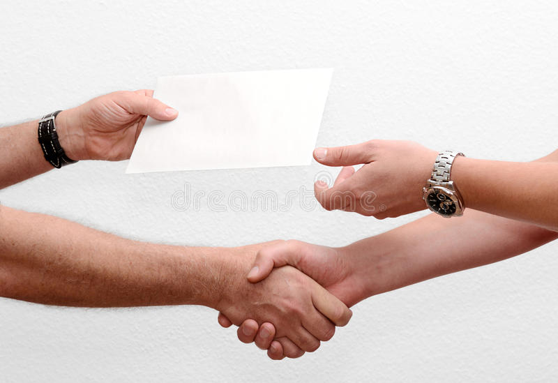Give someone money in envelop for corruption. Purposes stock photo