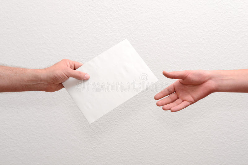 Give someone money in envelop. For corruption purposes royalty free stock image