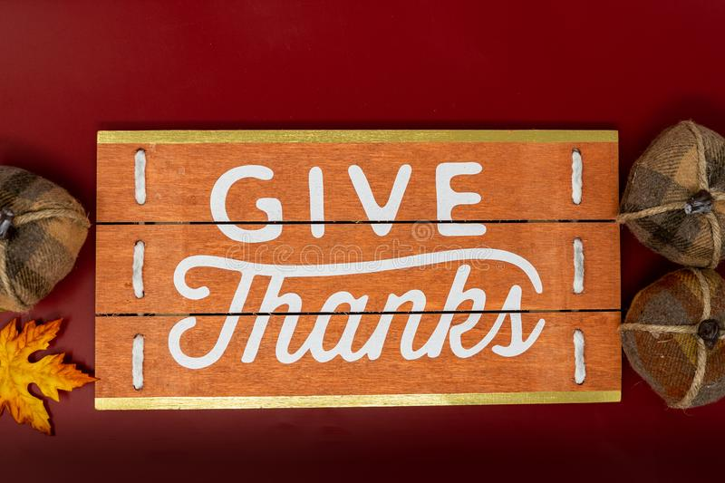 Give Thanks text phrase Thanksgiving holiday background with pumpkins royalty free stock photos