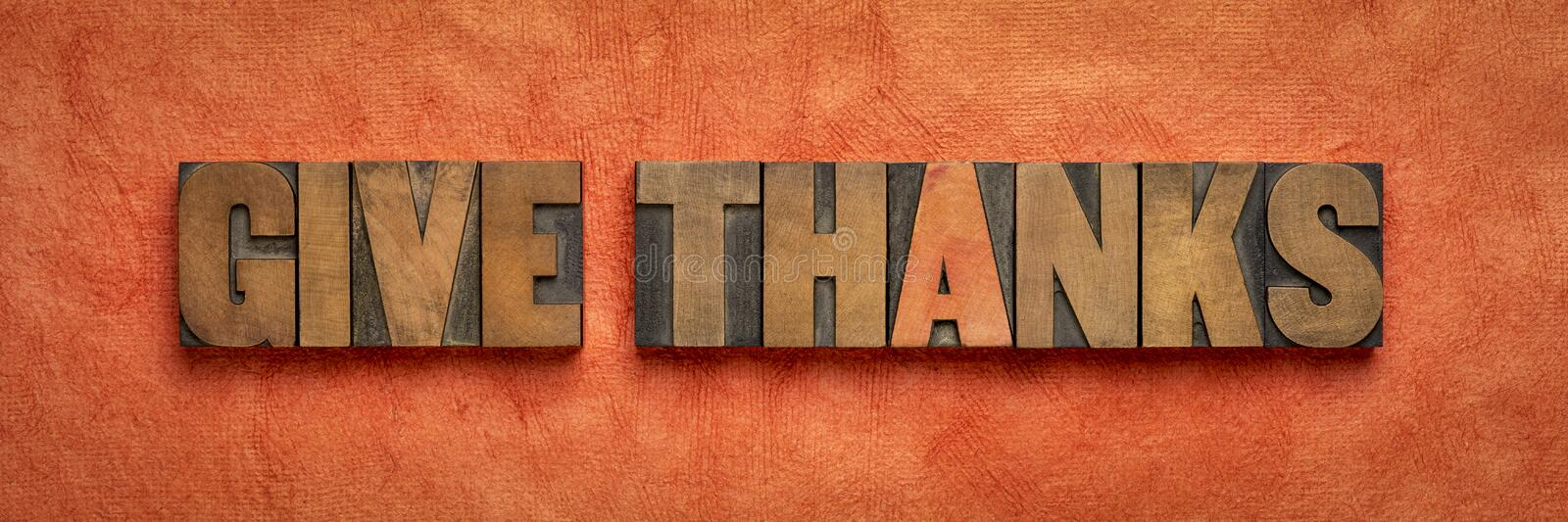 Give thanks - word abstract in wood type royalty free stock image