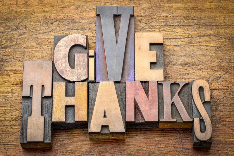 Give thanks - word abstract in wood type. Give thanks - word abstract in vintage letterpress wood type mixed fonts against rustic wooden background stock photography