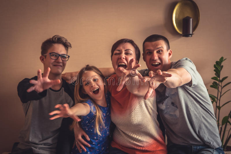 Give it to me family with pulling hands looking at camera royalty free stock photos