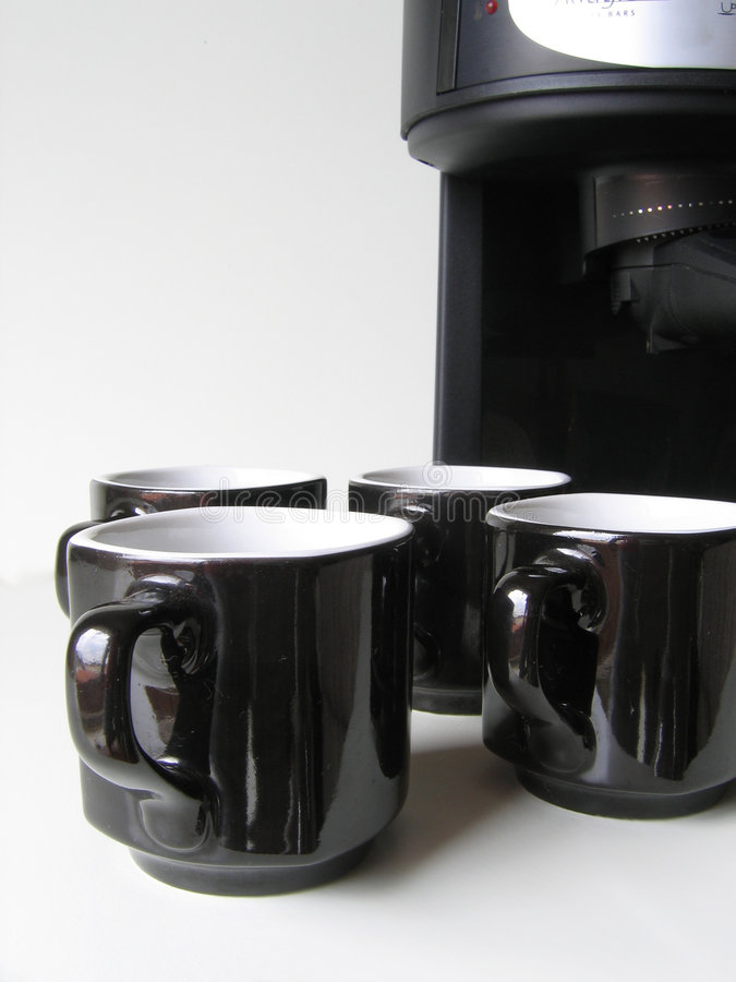Give Us Some Coffee 1. Some cups trying to get some coffee from a coffee machine royalty free stock photo