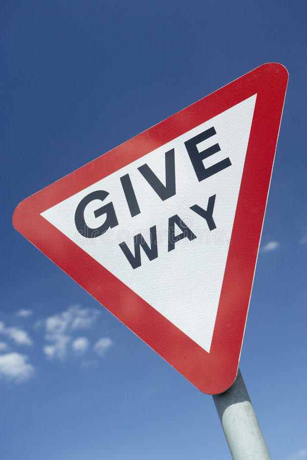 Download Give Way Sign Against A Blue Sky Stock Photo - Image: 8756854