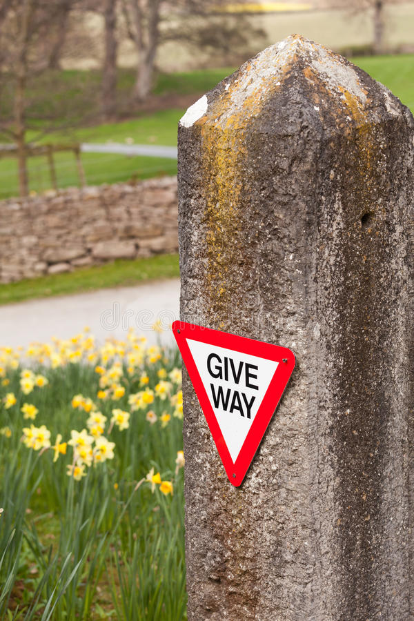 Give Way Sign On Old Stone Gatepost Royalty Free Stock Photo