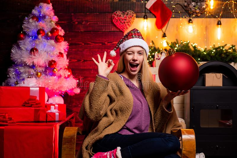 Give a wink. Crazy comical face. Christmas woman hold bomb. Creative boom. Bomb emotions. Beautiful Woman with Christmas stock photography