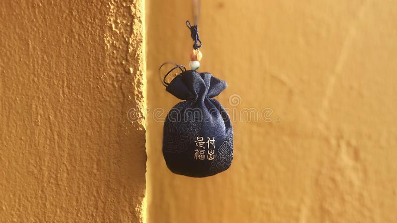 Giving is bliss. From LongHua temple,China royalty free stock image